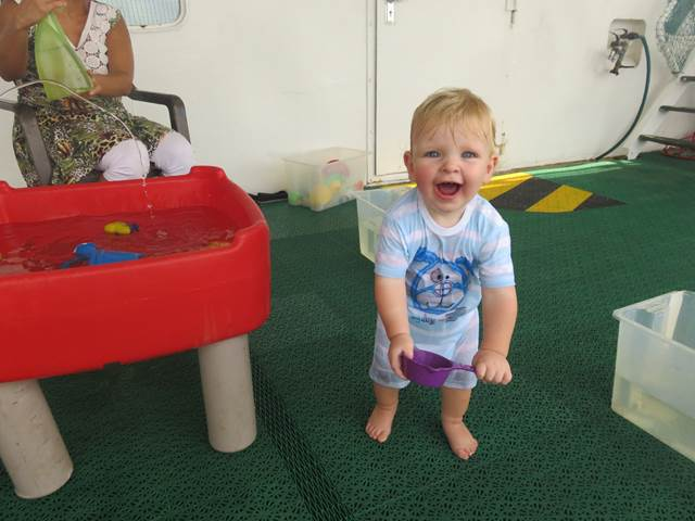 Joseph enjoying his first wet play at nursery