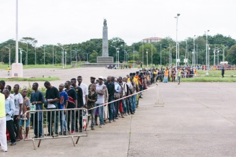People lined up outside the Palais du Peuple to be seen by one of the screening nurses at mass screening.